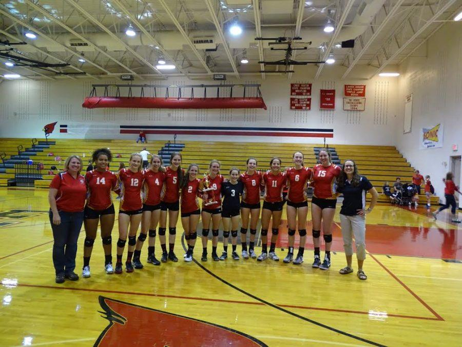 The Cougars pose after taking first place at the Elizabeth High School Early Bird Volleyball Tournament.