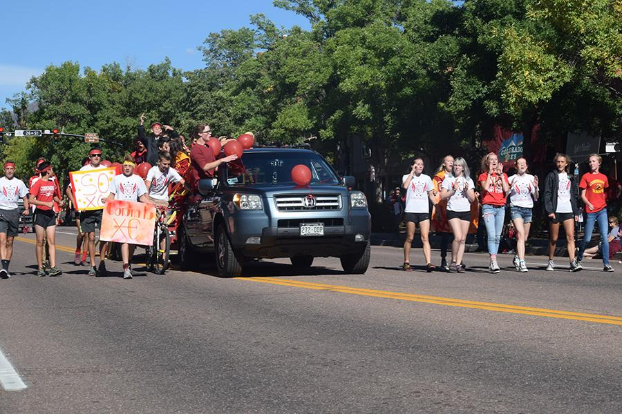 The generally inseparable cross country team marches down the street in the parade.  The team is considered one of the most close-knit groups at the school.