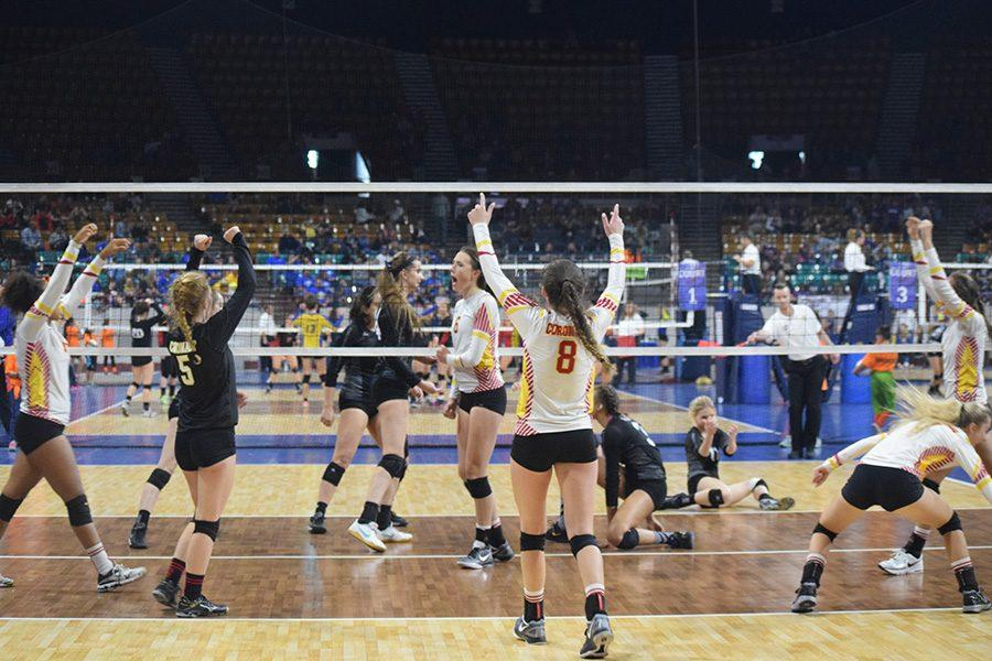 The Cougars celebrate a block at the Colorado State Volleyball Tournament in early November.