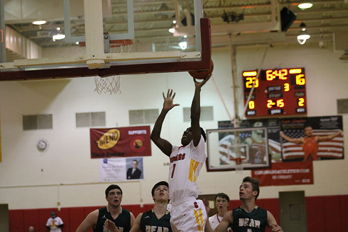 Senior Elijah Clanton attempts a lay-up in the Cougars 12/13 game against the Bear Creek Bears.