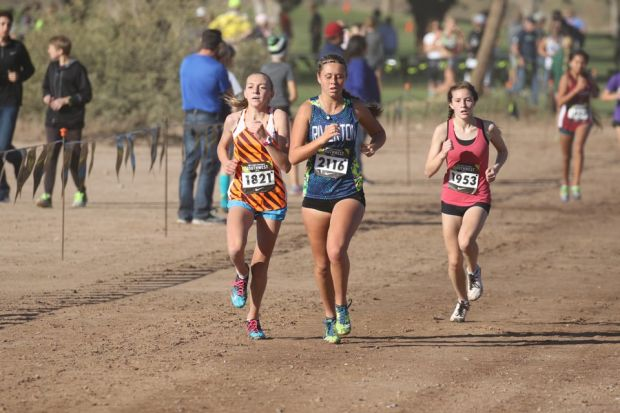 Taylor Dutton (right) finished tenth in the Girls Large School Race at Nike Cross Regionals. Photo by Alan Versaw.