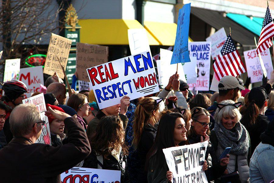 Protesters hold signs and American flags at the Colorado Springs Womens' March on 1/21.