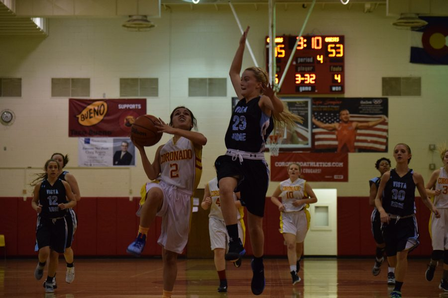Alese Abitia, 12, drives to the basket