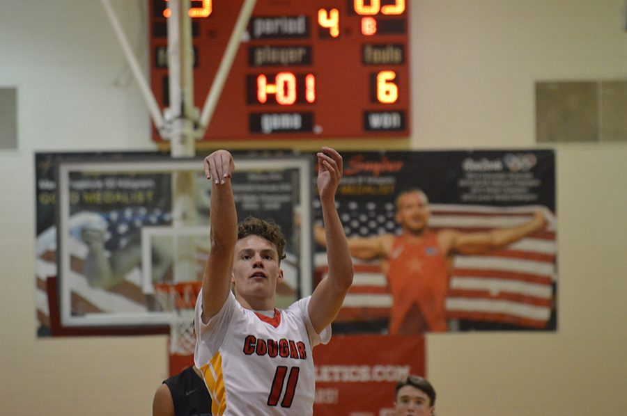 Junior Kaddin Standley shoots a free-throw in the Cougars 1/2 game against Pomona High School.
