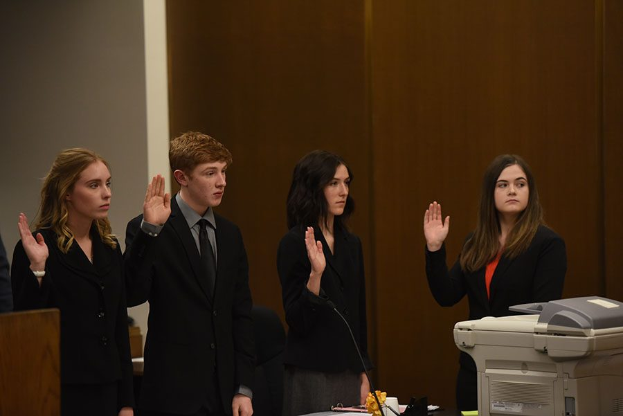Abby Bean, 12, Noah Durrance, 10, Sierra Meisner, 10, and Rachel Wilsey, 12, being sworn in before the judge at their competition.