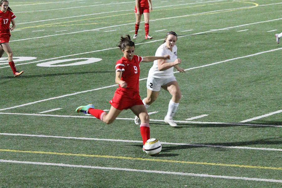 Brooke Williams, 10, saves the ball and passes up the sideline towards the goal!