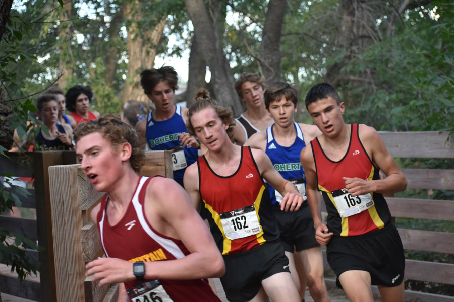 Conor+Strizich+and+Ben+Swanson+work+together+to+lead+the+boys%27+varsity+team+to+a+strong+finish+at+the+Cheyenne+Mountain+Stampede.