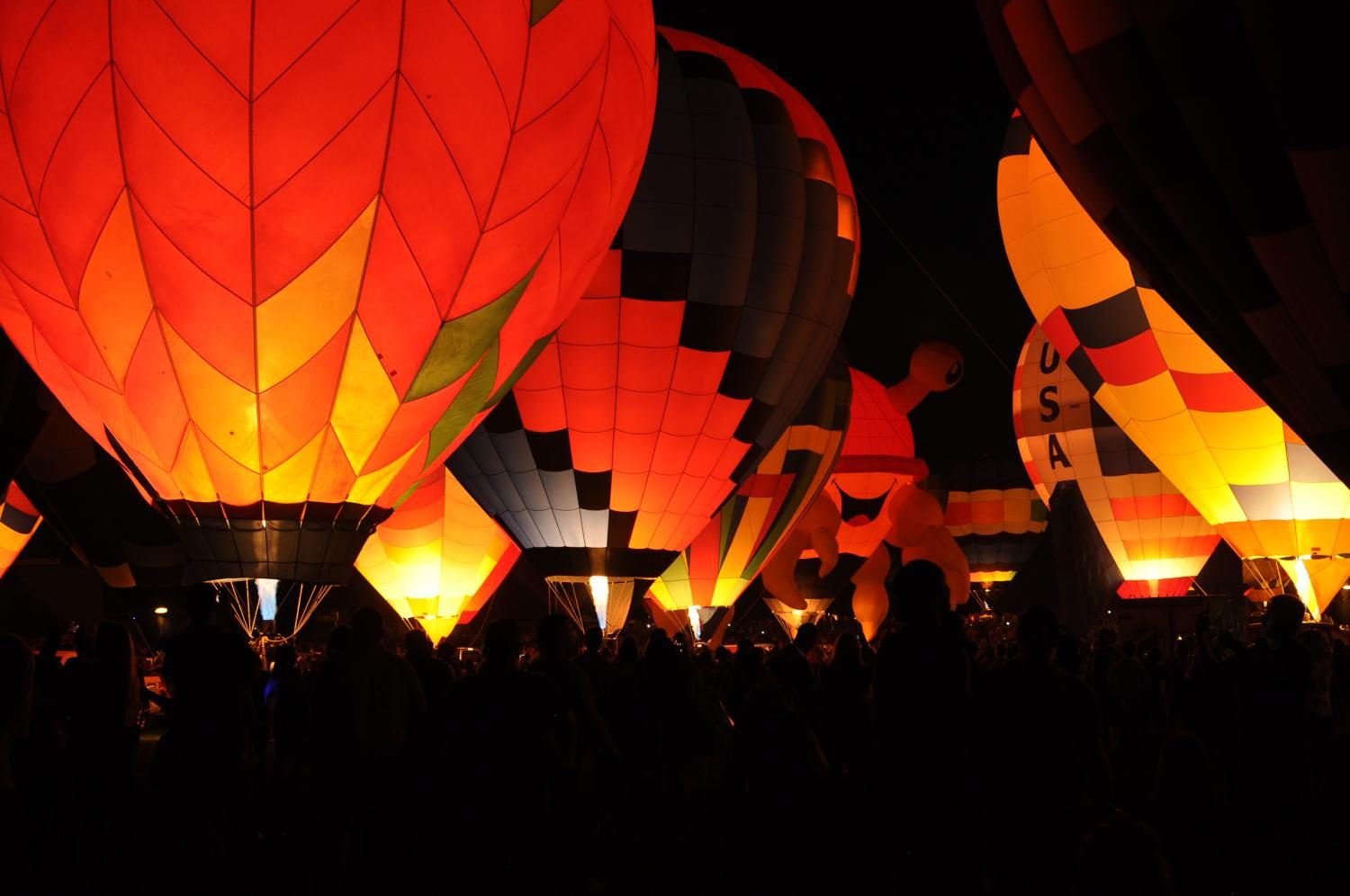 Hot air balloons light up the night sky of Colorado Springs