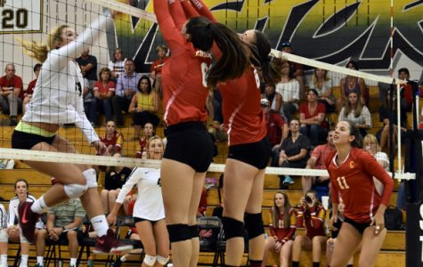 Seniors Jaelyn Hershberger and Mara Abernethy put up an impenetrable wall of defense against Mt. Vista.