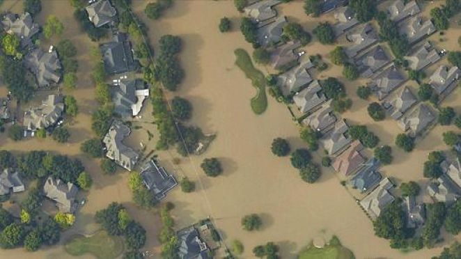 An aerial view of a neighborhood in Houston flooded by Hurricane Harvey (NOAA). Do your part to help the victims of Hurricane Harvey by donating socks to Coronado.