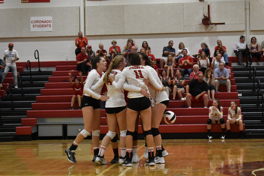 Varsity volleyball team preparing to finish off the Pine Creek Eagles.