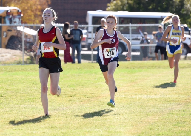 Chloe Cassens,12, of Coronado, takes the lead in a final push to the finish to become the 5A Metro League Champion.