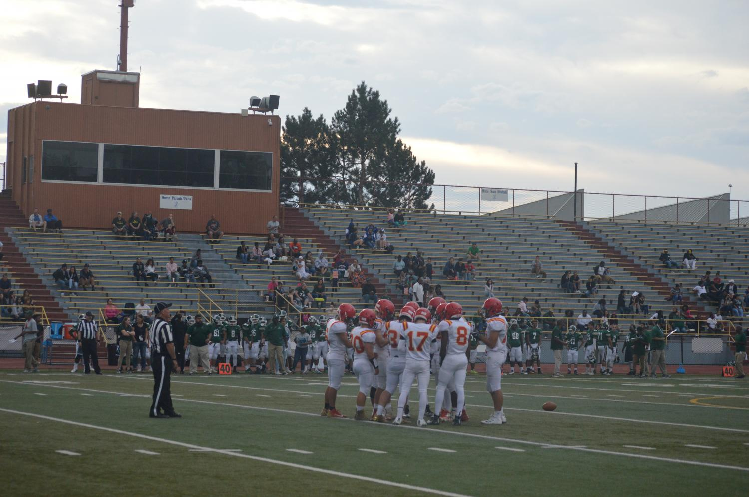 Cougars huddle to determine their next play against Pueblo West.