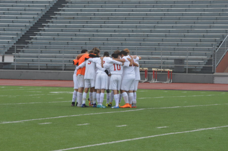 The team huddles together before a game.