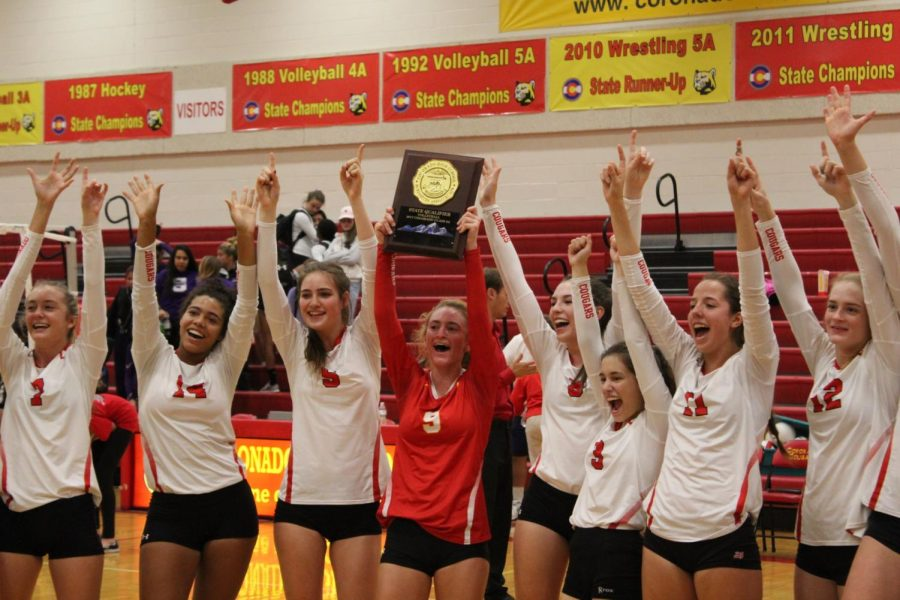 The Cougars celebrate after winning both matches in straight sets.