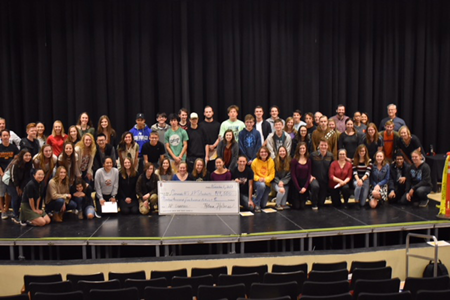 Students pose with the check earning $19,500.
