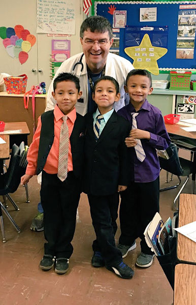 Coronado West Side Award recipient Terry Martinez with his elementary school students, who dressed him up, on Career Day.