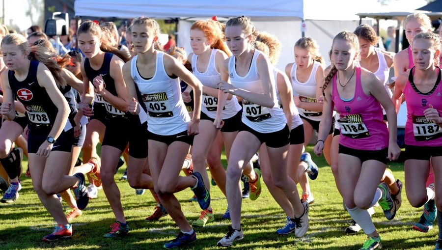 Chloe Cassens and returning runners Grace Abernethy and Maddy Morland off to a strong start.