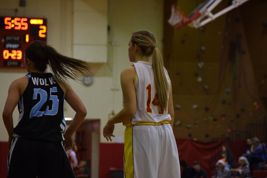 Madi Eurich makes her way around the court contributing to the score.