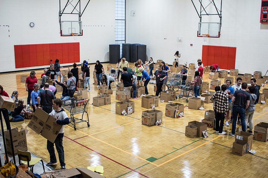 Students help prepare boxes of food to give to Coronado families for Thanksgiving.