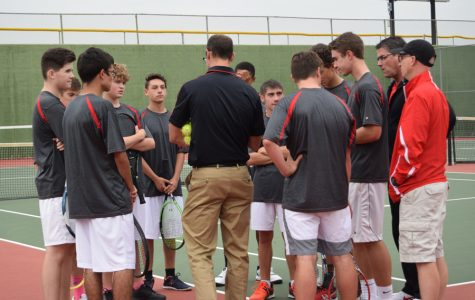 Varsity men's tennis huddles during the 2017-2018 season; men's tennis' entire roster was recognized by the CSML.