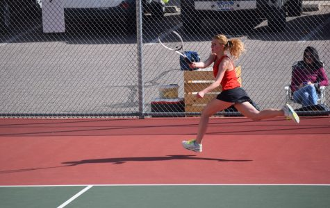 Senior Bethany Heitland chases after a ball during the 2016-2017 season.