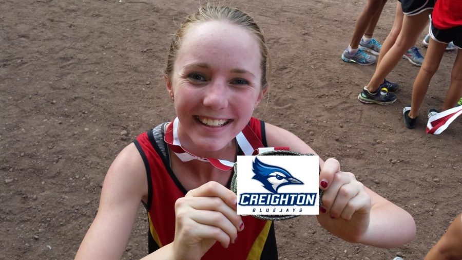 Senior+Chloe+Cassens+is+all+smiles+after+commiting+to+run+collegiate+cross+country+at+Creighton%21
