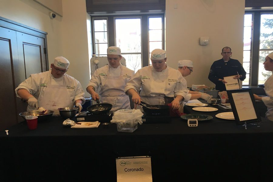 Coronado%27s+ProStart+team+working+hard+in+the+kitchen+at+the+competition%21