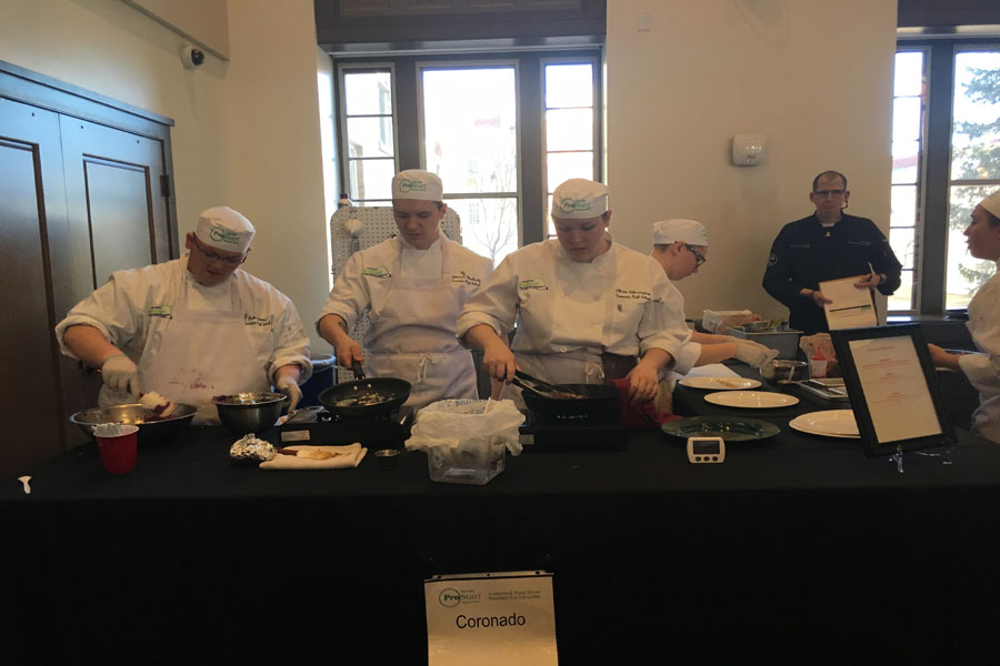 Coronado's ProStart team working hard in the kitchen at the competition!