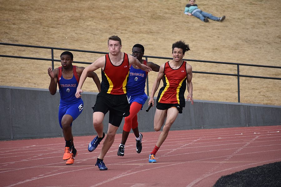 The 4x100 relay comes through the final turn.