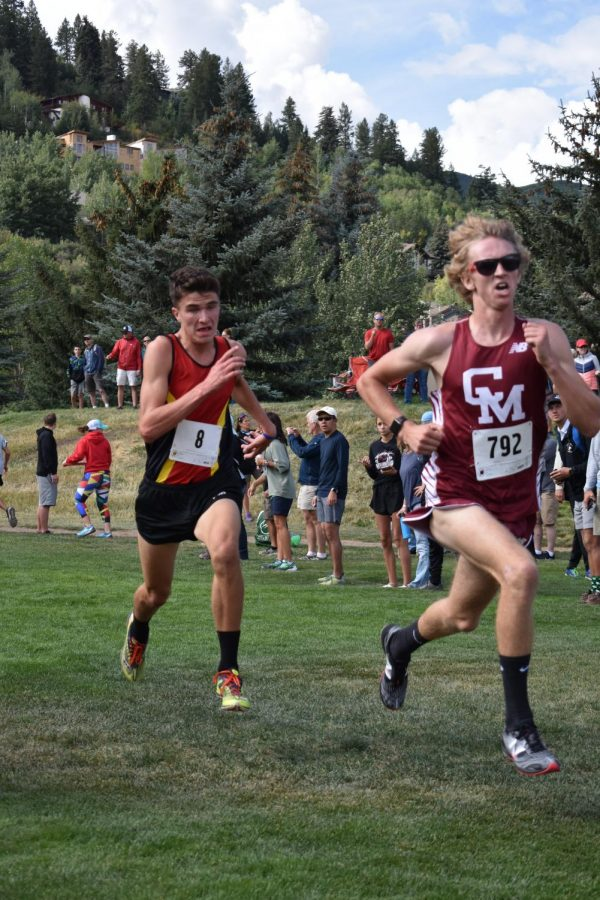 Ben Swanson chases down Cheyenne Mountains number 2 runner during the last 50 meters of the race at Battle Mountain. You dont mess with a guy who can run a 1;56 half mile; Swanson passed him to take 3rd place overall.