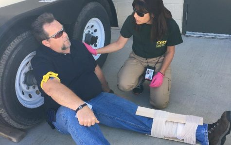Emily Boehlke helping to train new CERT students in a mock emergency response scenario.