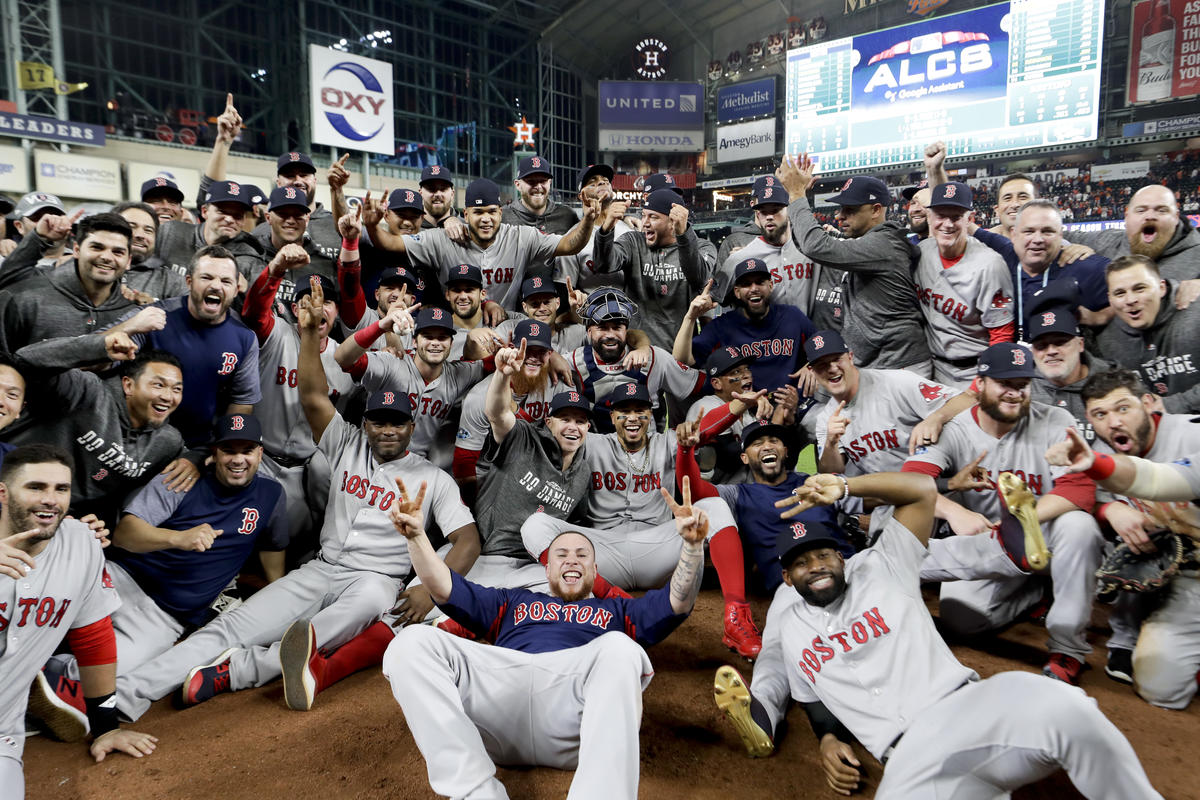 The Boston Red Sox pose for a picture after winning the baseball American League Championship Series against the Houston Astros on Thursday, Oct. 18, 2018, in Houston. Red Sox won 4-1.