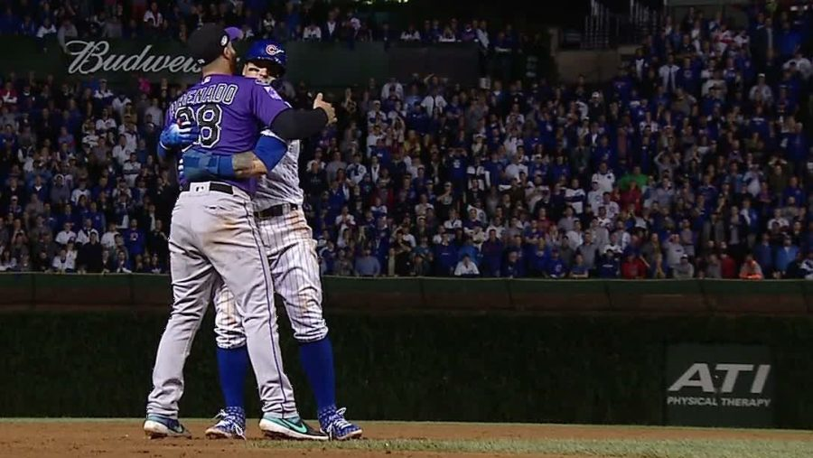 Rockies+third+baseman+Nolan+Arrenado+gives+Chicago+Cubs%27+Javy+Baez+a+congratulatory+hug.+Baez+and+his+squad+are+the+winners+of+everything.