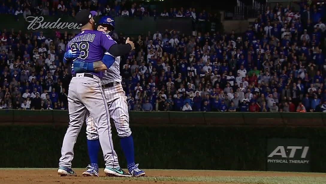 Rockies third baseman Nolan Arrenado gives Chicago Cubs' Javy Baez a congratulatory hug. Baez and his squad are the winners of everything.