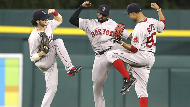 Left+to+Right%3A+Andrew+Benintendi%2C+Jackie+Bradley+Jr%2C+and+Mookie+Betts+celebrate+after+a+win.