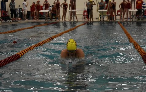 A Coronado swimmer competes in the breaststroke.