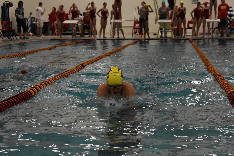 A Coronado swimmer competes in the breaststroke.