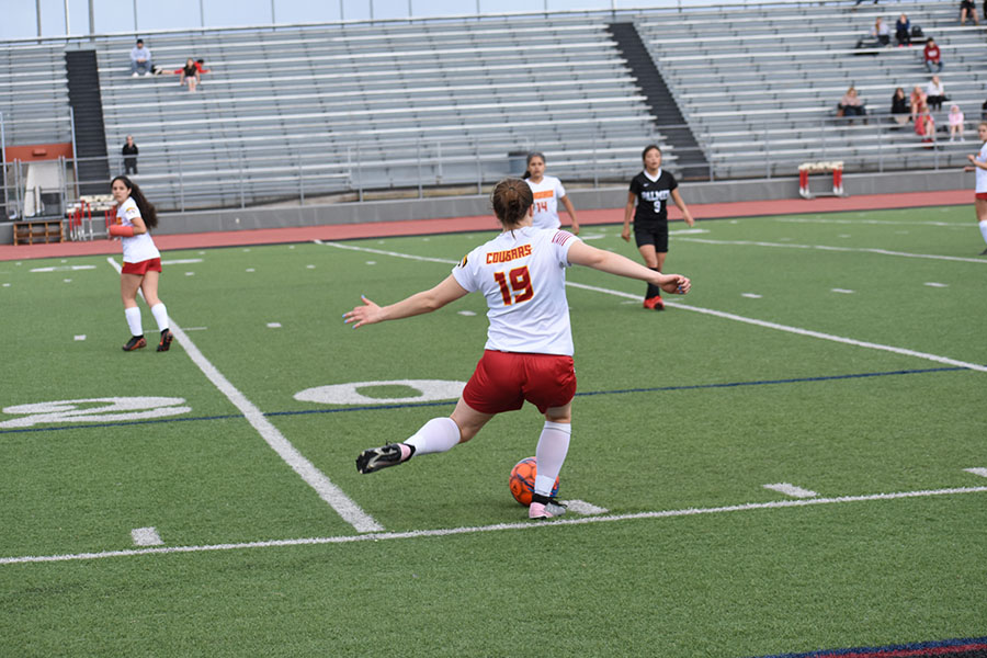Lauren Strizich, 11, making a pass towards the goal.