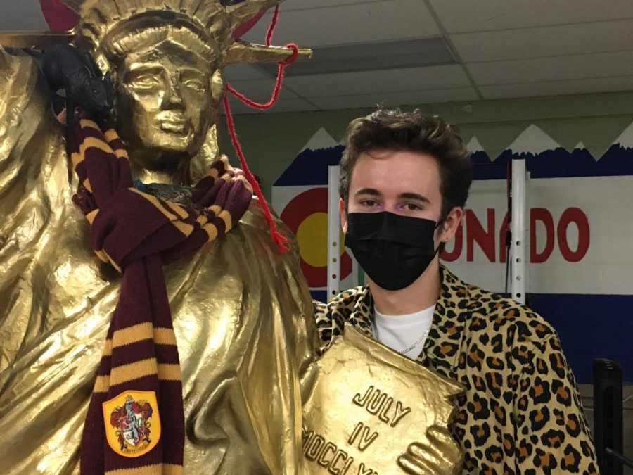 Andrew Curdy, So., hangs out with Lady Liberty because he feels free when wearing his leopard shirt!