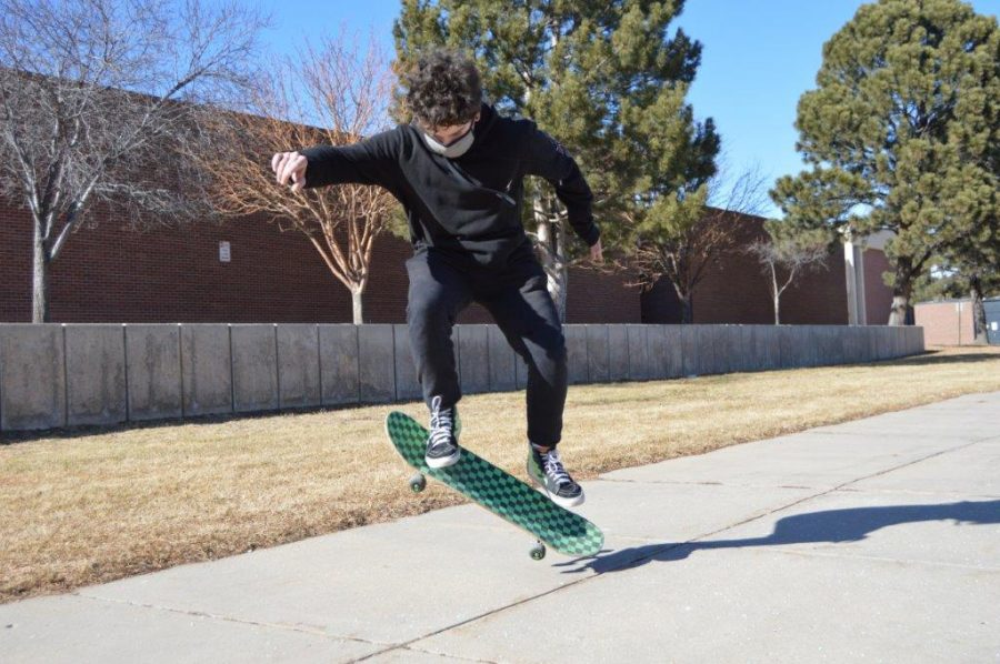 Sophomore Draco Leonard does some sweet moves upon his board of skating.